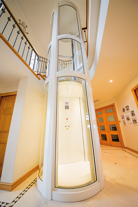 luxury round home lift with white detailing