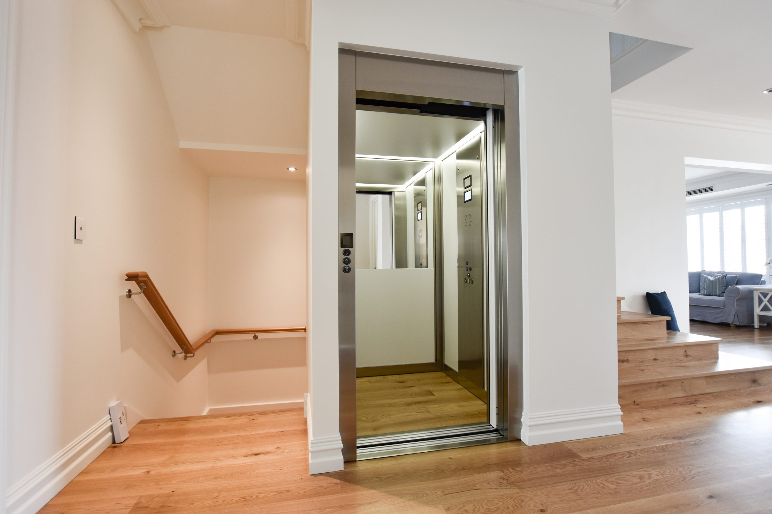 jewel home lift with custom wood floors and half height mirror
