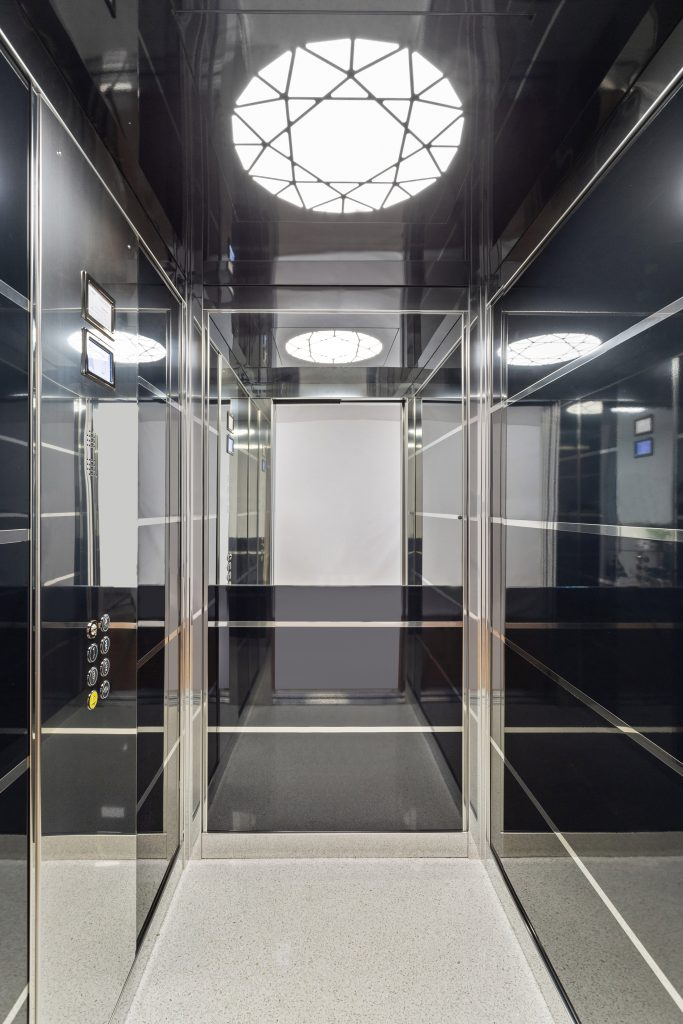 inside a sovereign home lift with mirrored skinplates and designer lighting