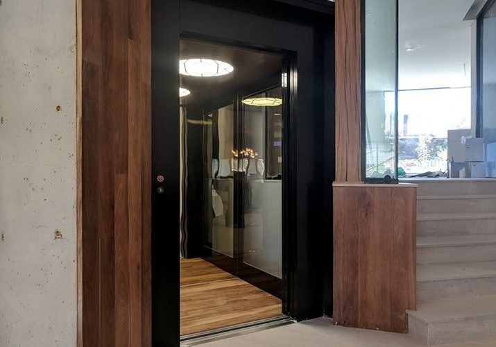 royal home lift installed in wooden feature wall