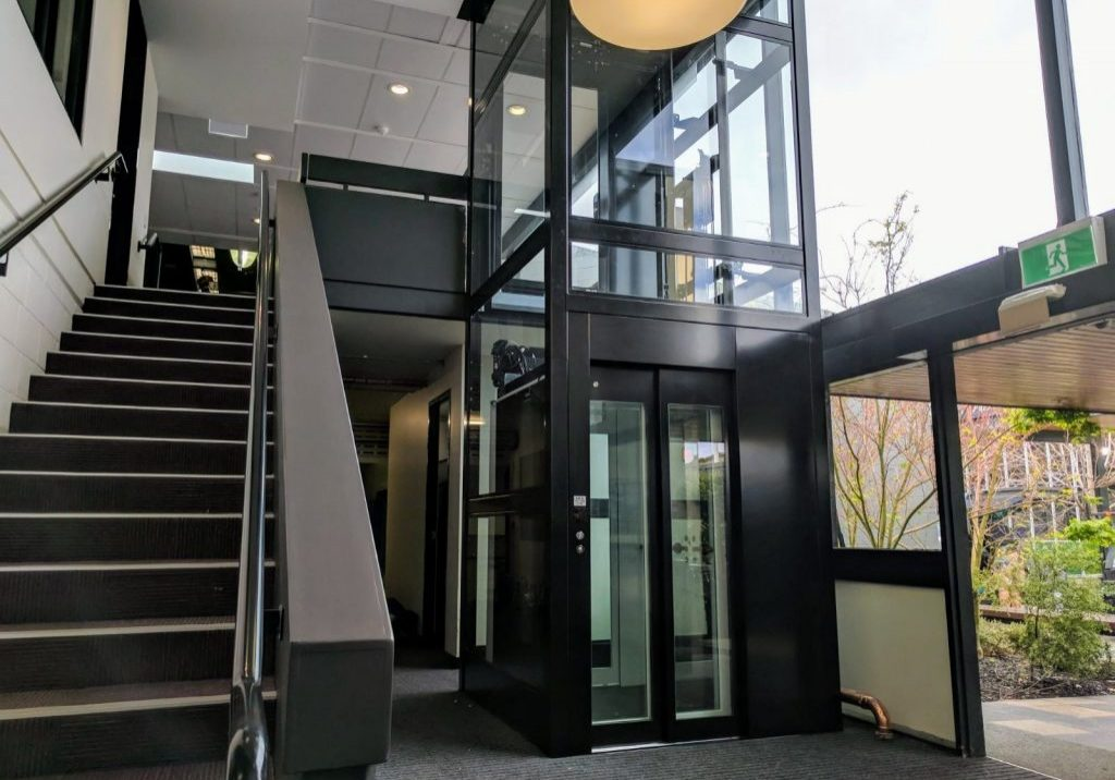 large commercial elevator installed inside a high school