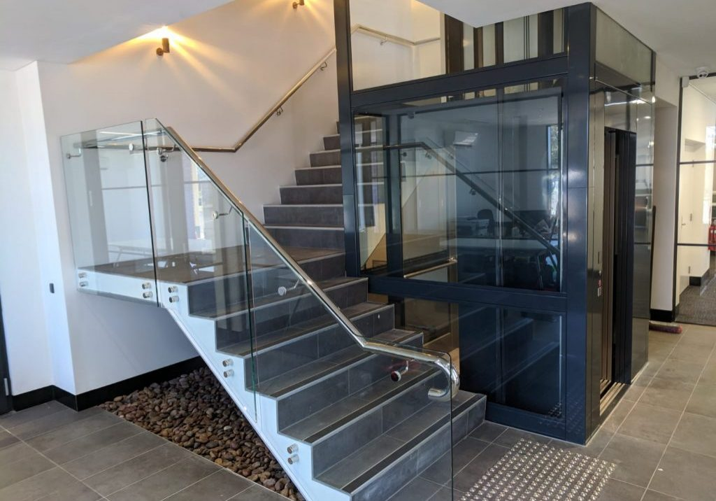 black and glass big lift perth inside business ground floor