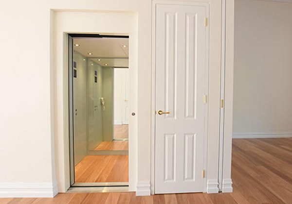 white lift with wooden floors