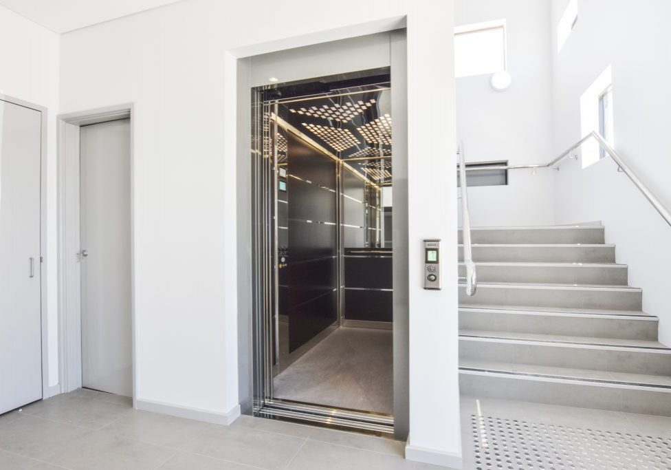 large elevator with doors open in hospital