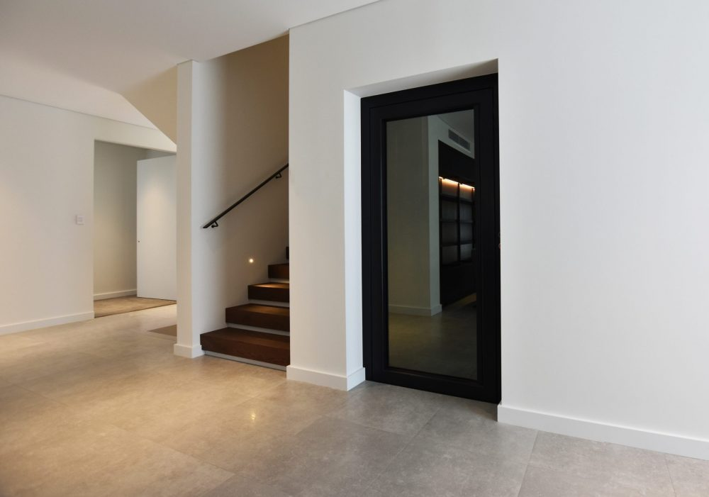 elevator for a new building which blends into a white and stone look