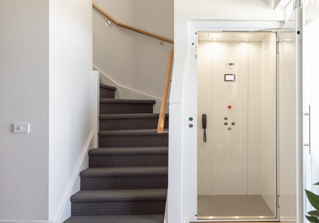 white classic lift design with swing door
