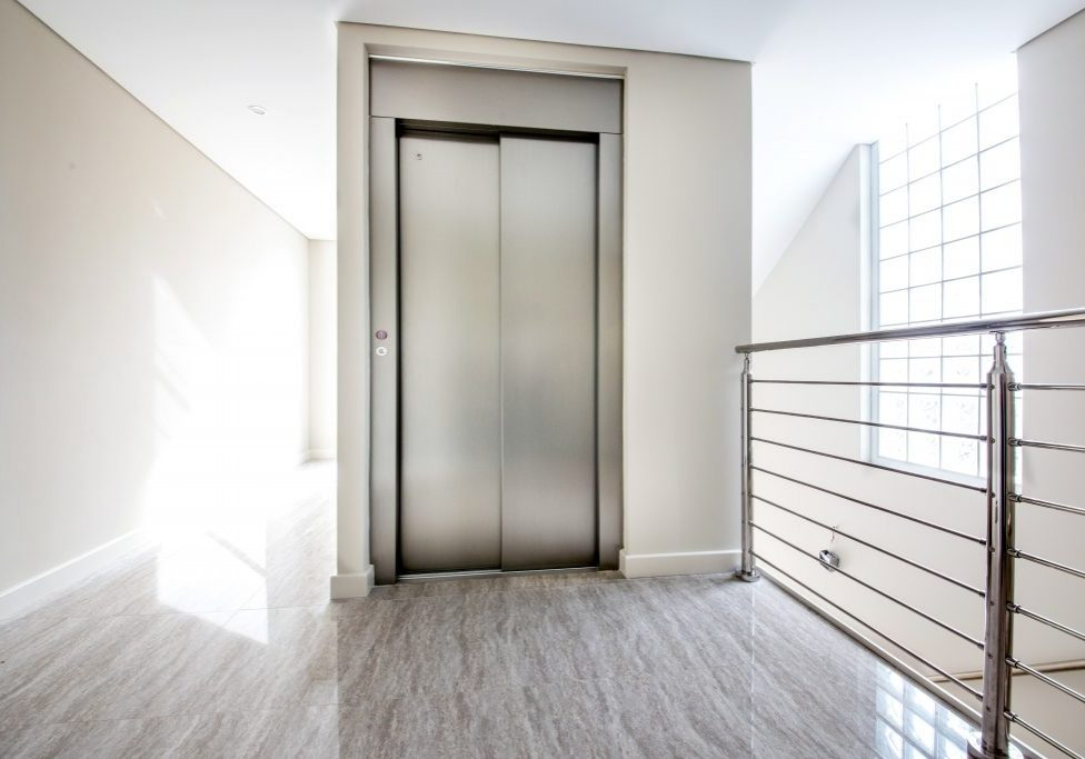 minimal stainless steel home lift