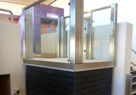 small lift with glass and steel