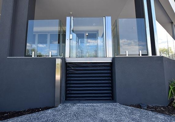mini lift with a dark design and glass feature