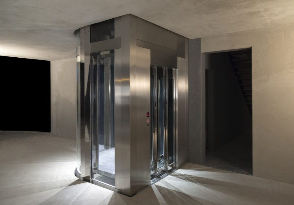 glass and stainless steel jewel home lift installed in new build