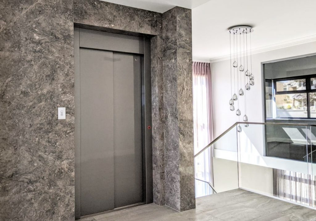 royal elevator design installed in marble feature wall