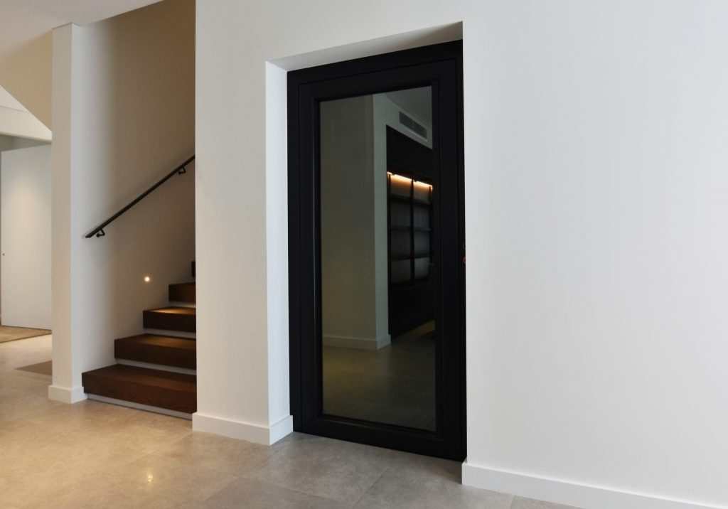 stylish home lift with tinted glass